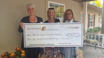 Stephanie and Dorothy present cheque to Carpenter Hospice