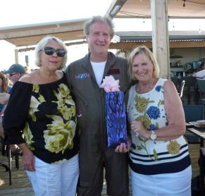 Phil receiving best costume prize from Sandy & Trish
